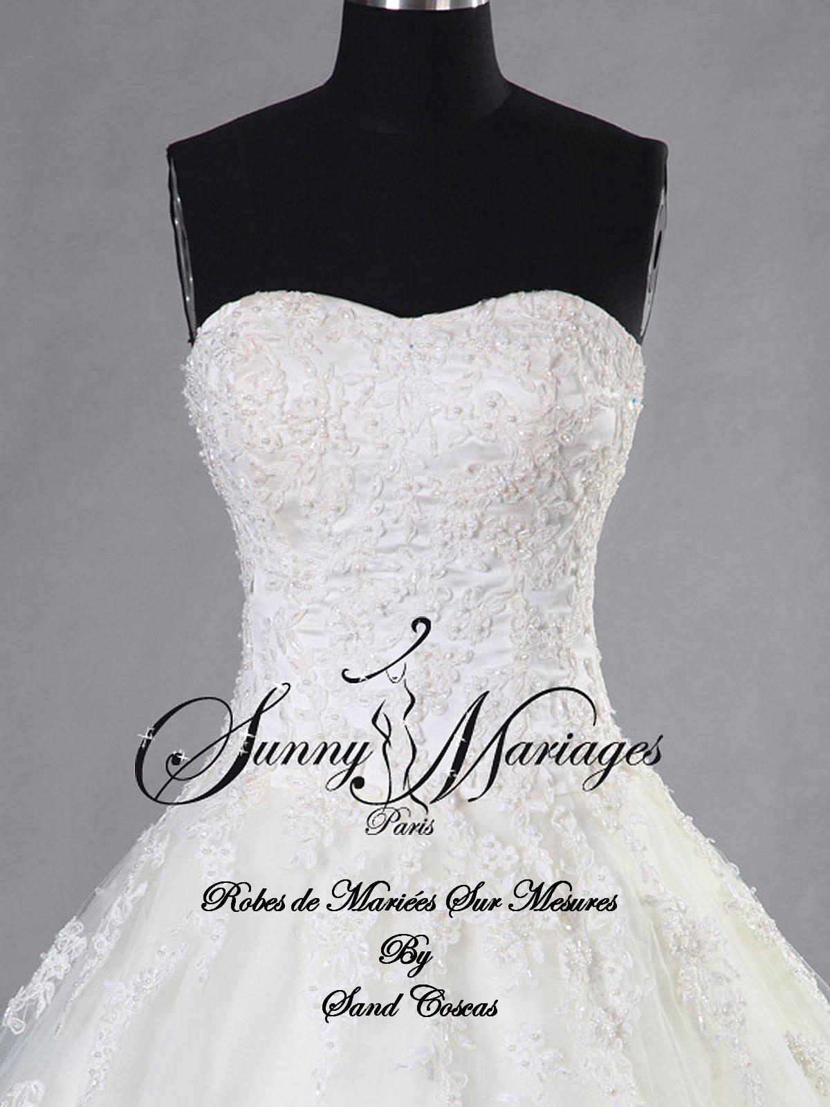 Robe de mariée princesse bustier dentelle et perle jupe en tulle